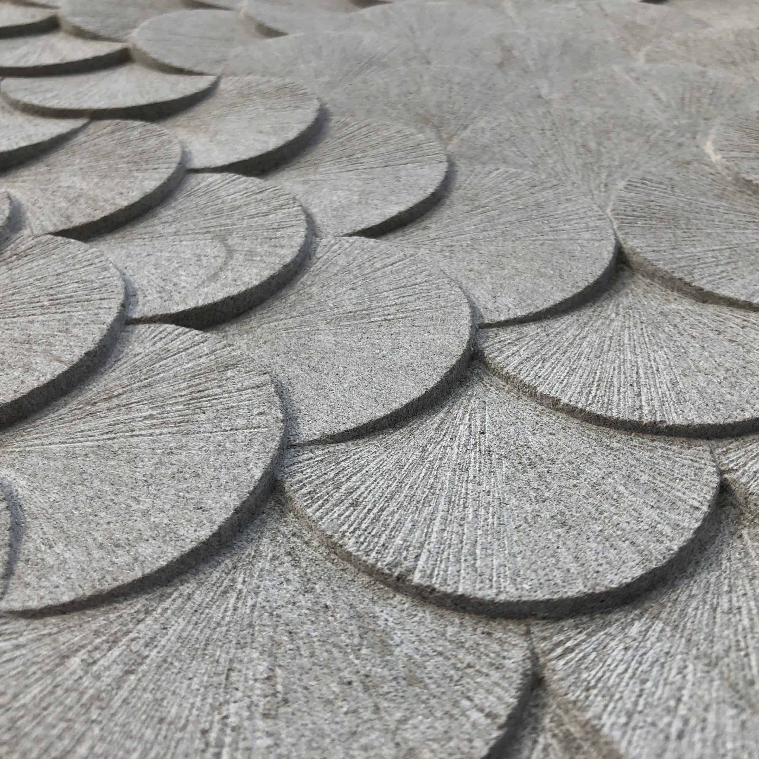 detail of stone carving, circular discs overlapping one another