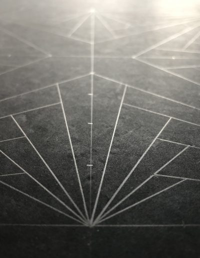 Geometric pattern drawn on slate