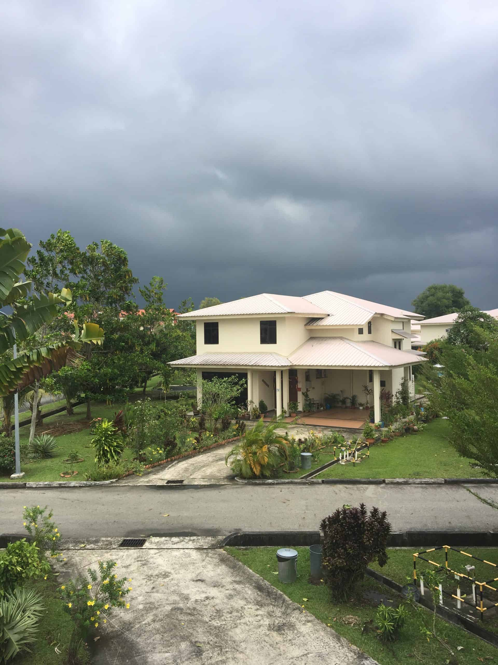 view of a house against a stormy sky