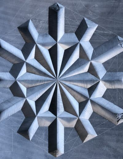 Many many lines carved in a wheel like pattern