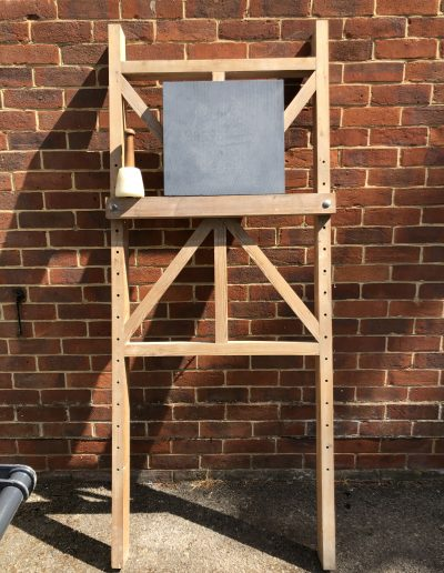 Easel with stone on standing in the sunshine