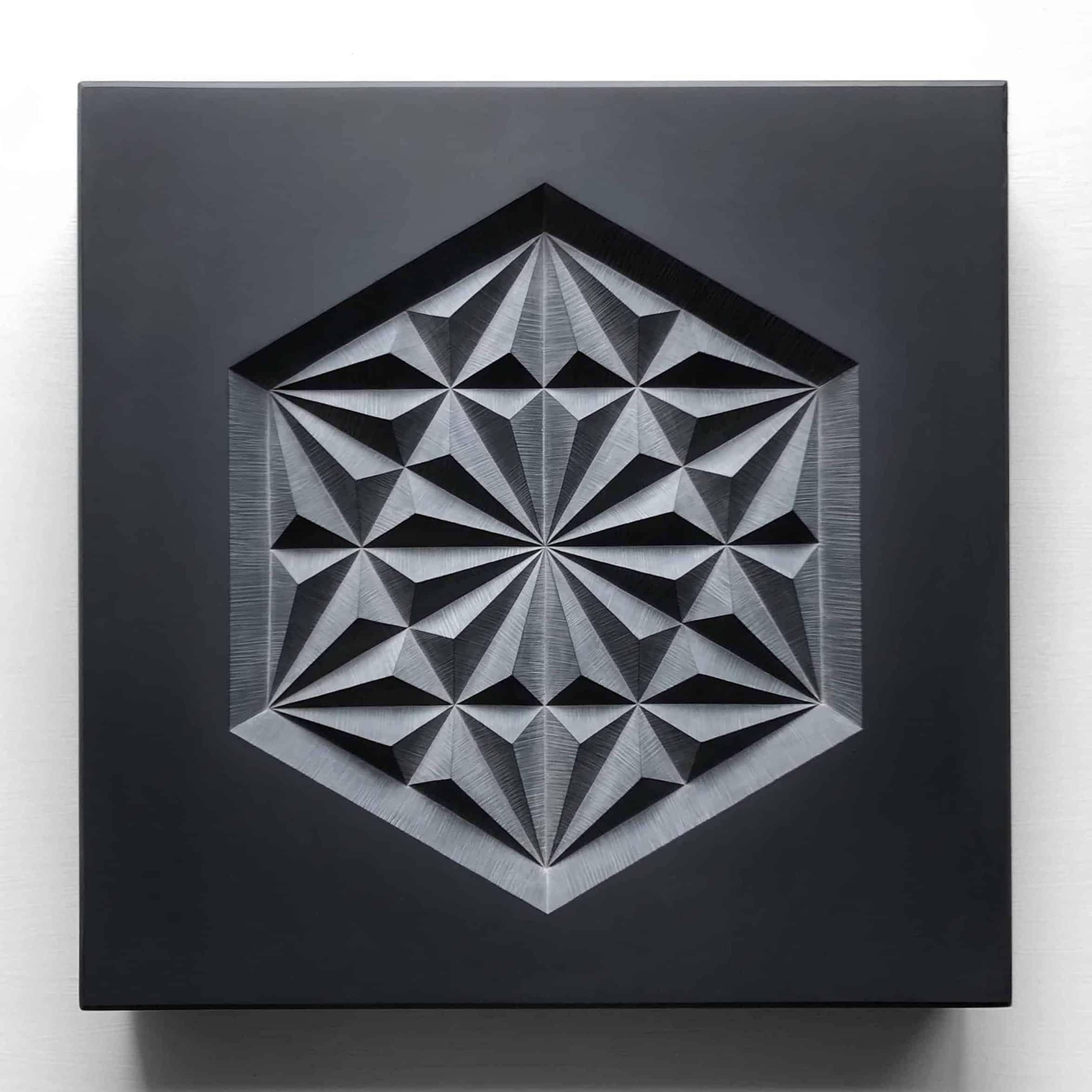 Carved geometric pattern in slate