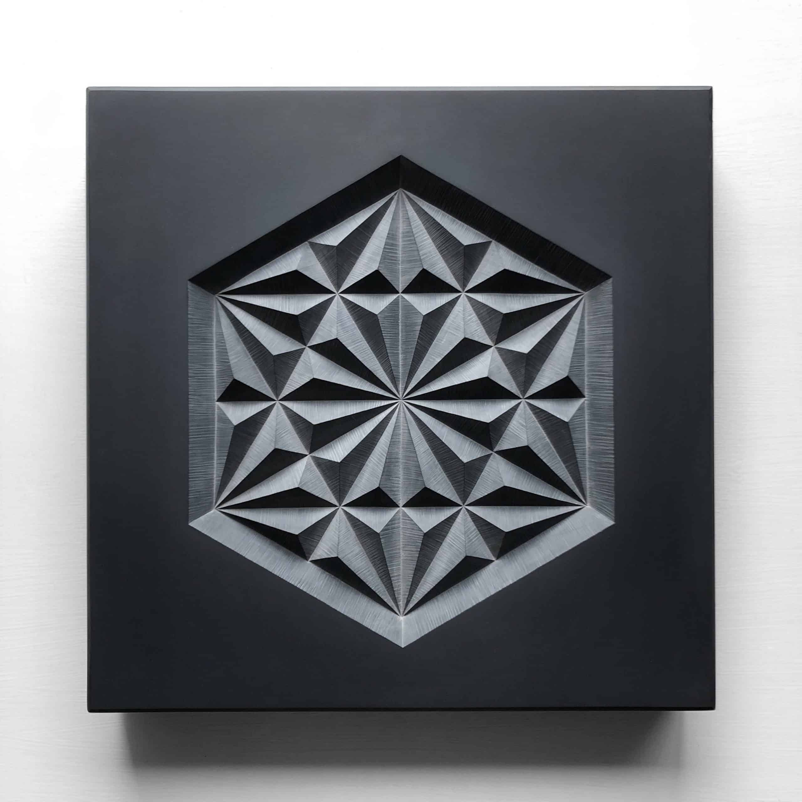 Carved geometric pattern in slate