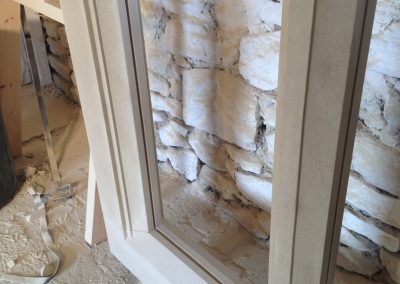 Corner detail of the Stone mullion window in the workshop