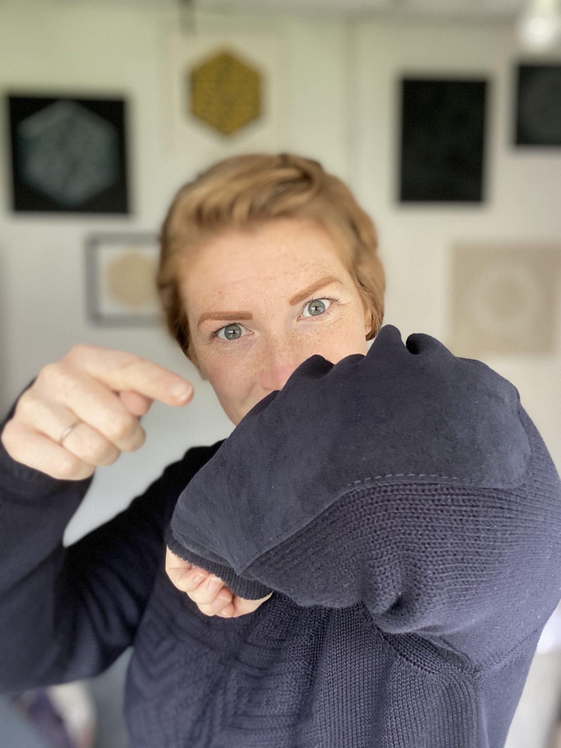 Zoe Wilson wearing her bespoke John Smedley Jumper