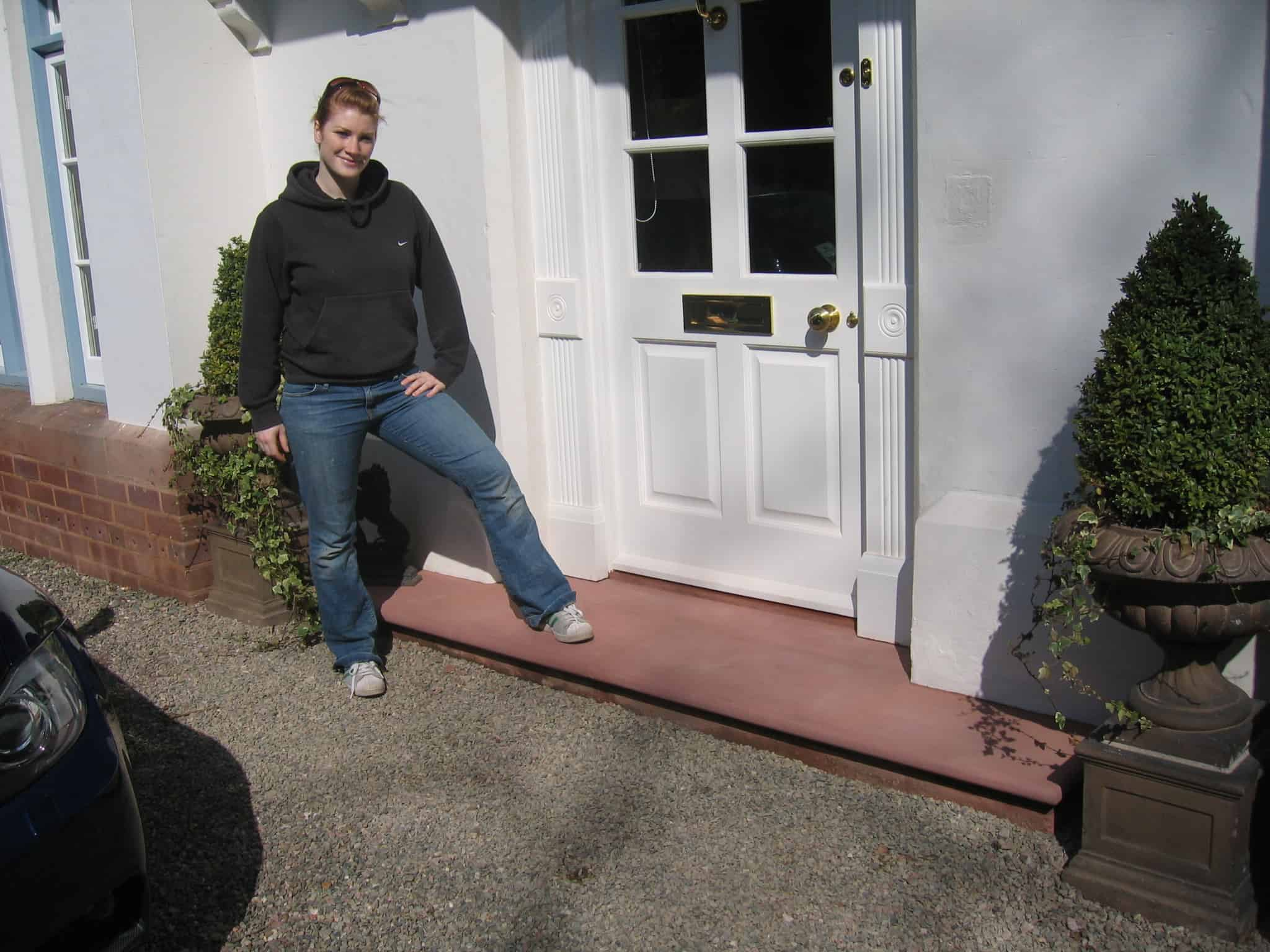 Zoe Standing next to the first front door step she made out of stone
