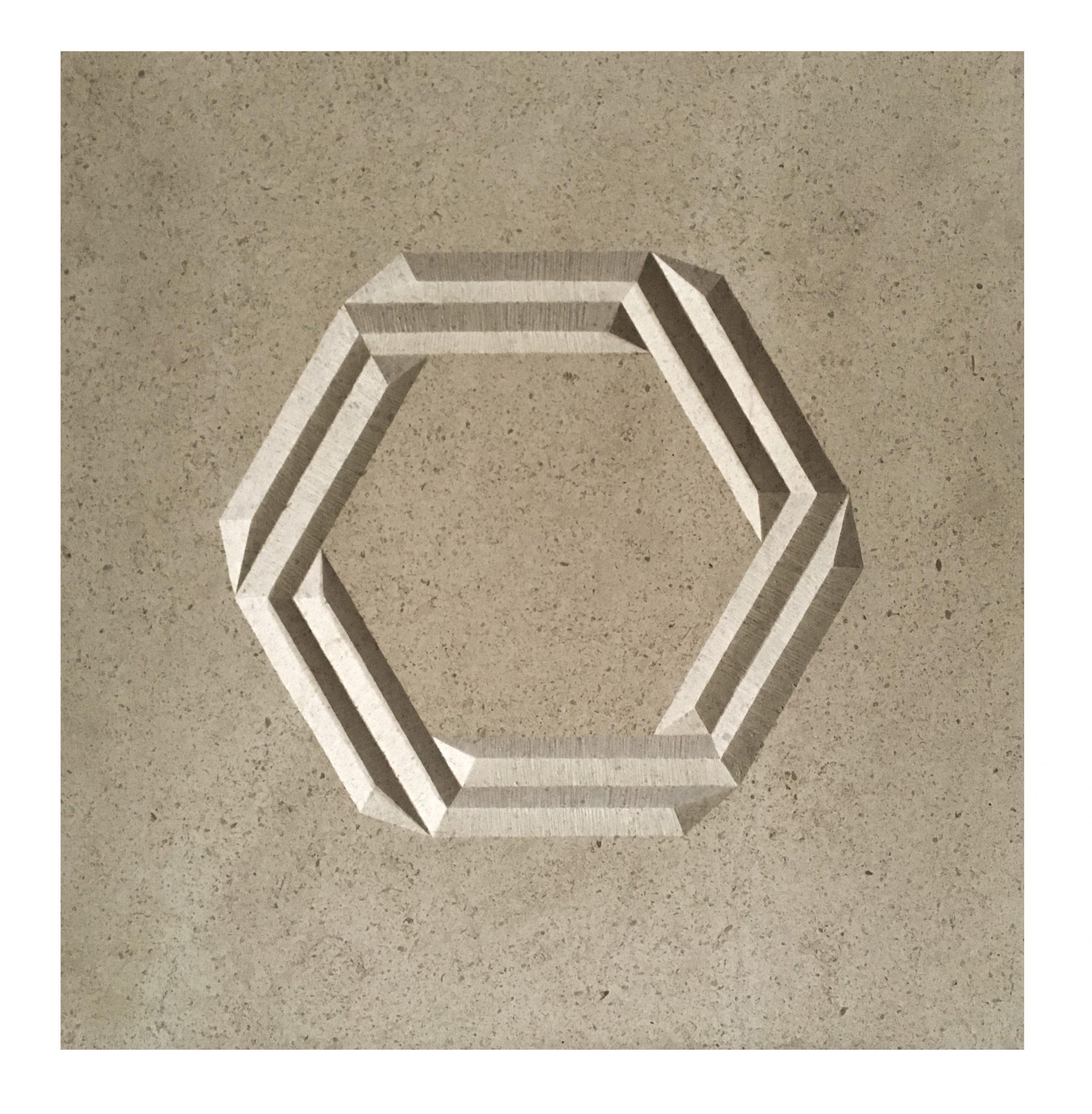 Geometric pattern carving into cream limestone