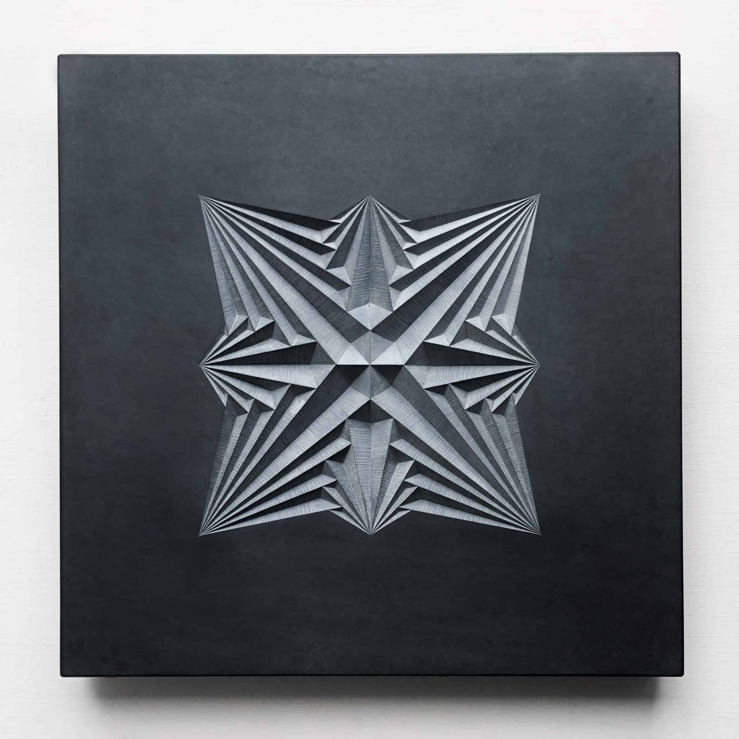Geometric patter carving into welsh slate by Zoe Wilson