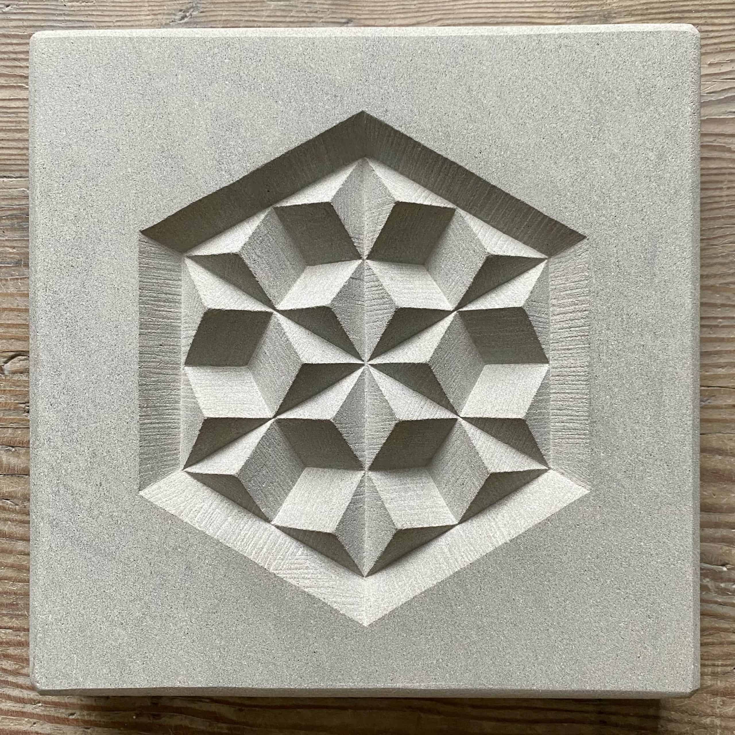 Hand carved geometric pattern in a buff colour Portland limestone
