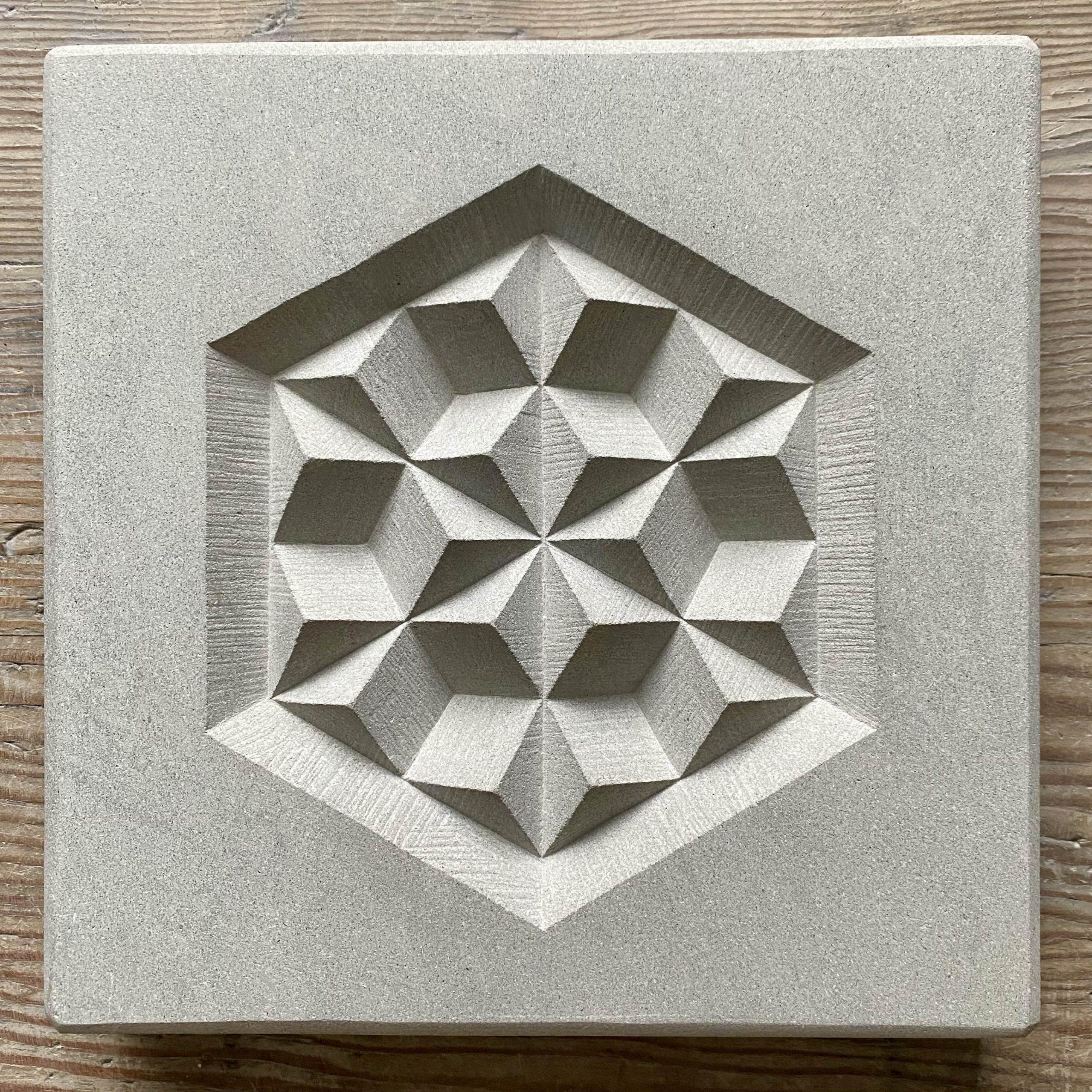 Hand carved geometric pattern in a buff colour Portland limestone