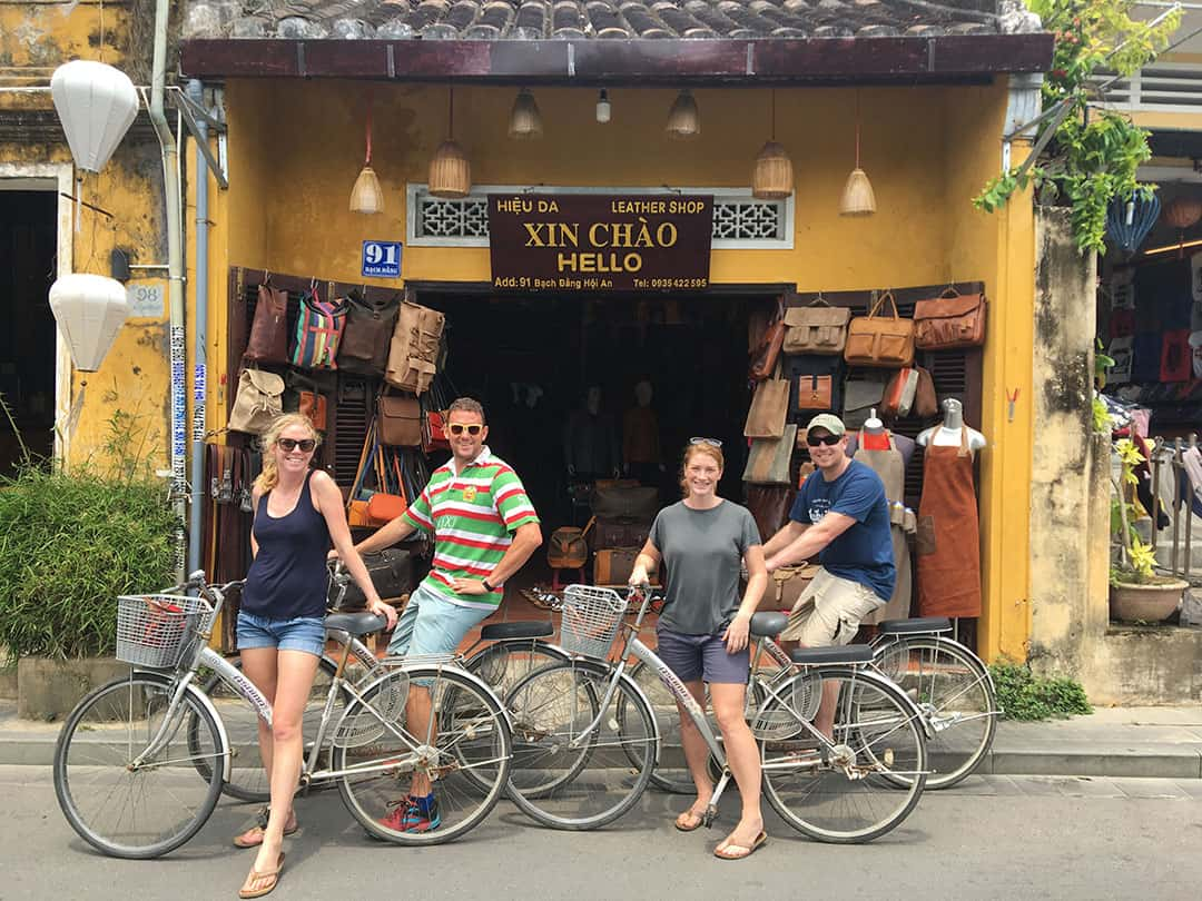 Zoë Wilson and friends on bikes outside a leather workshop in Hot An, Vietnam