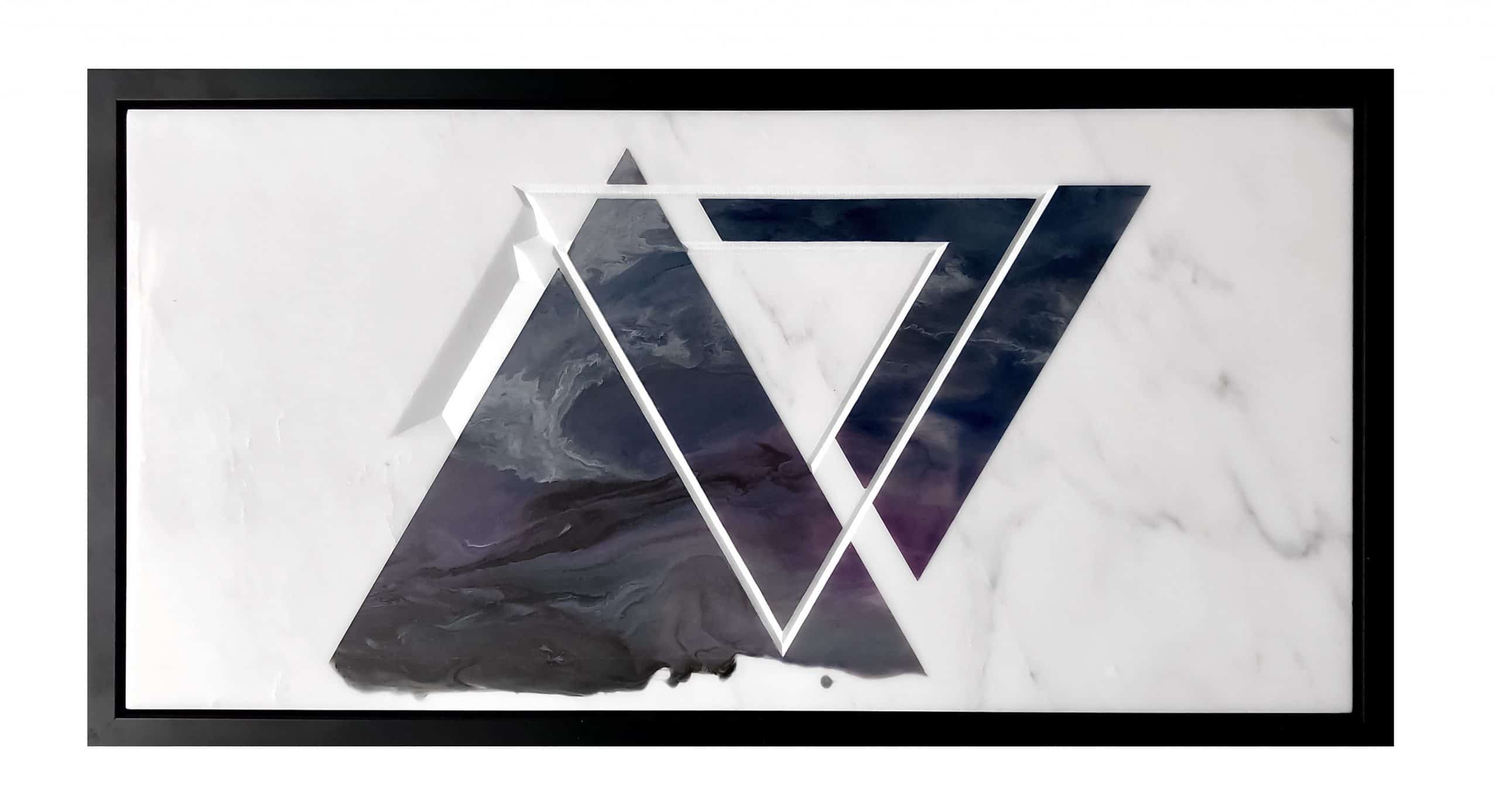 Triangle pattern carved into white marble and painted triangles in dark purple