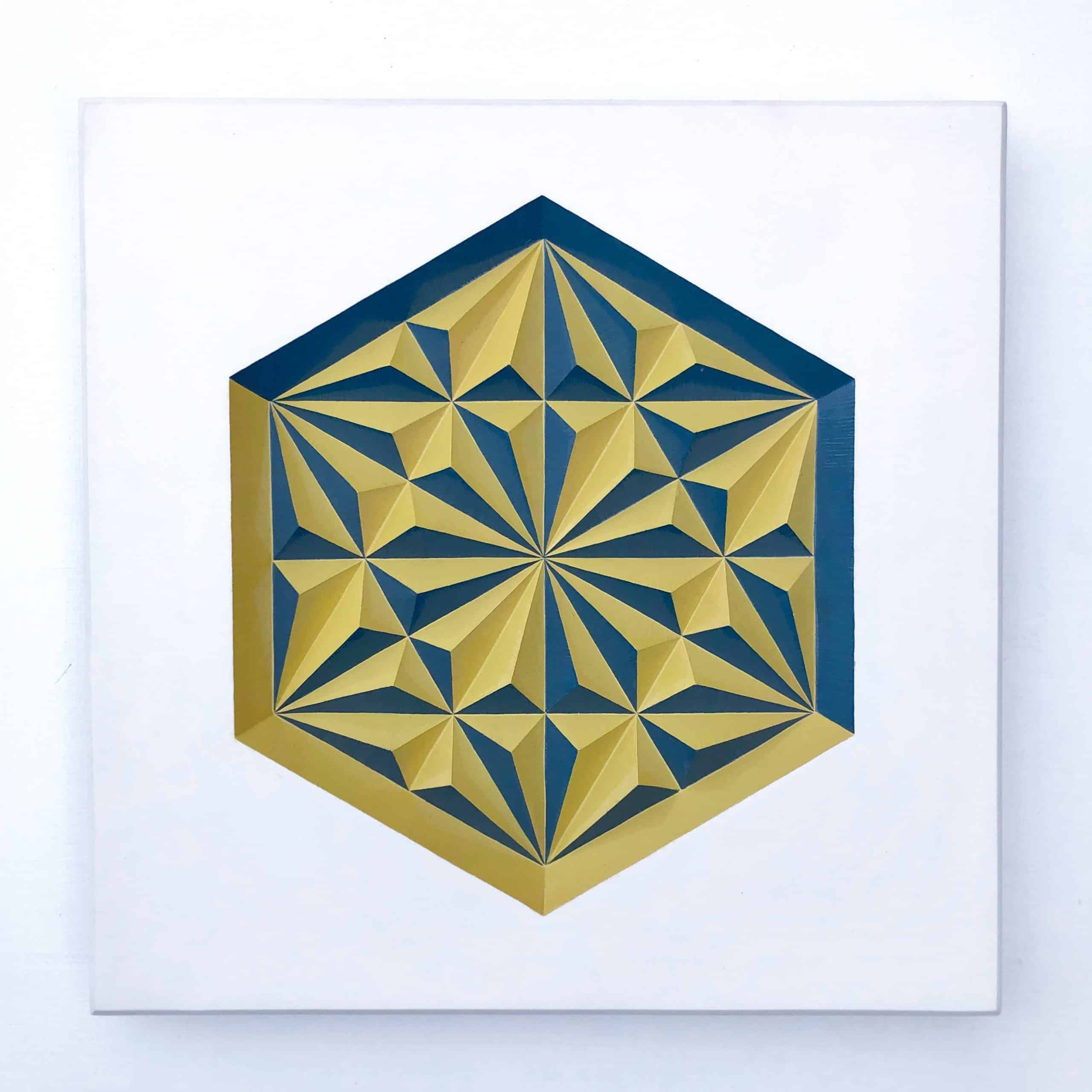 White plaster cast of geometric pattern painted in yellow and blue enamel paint