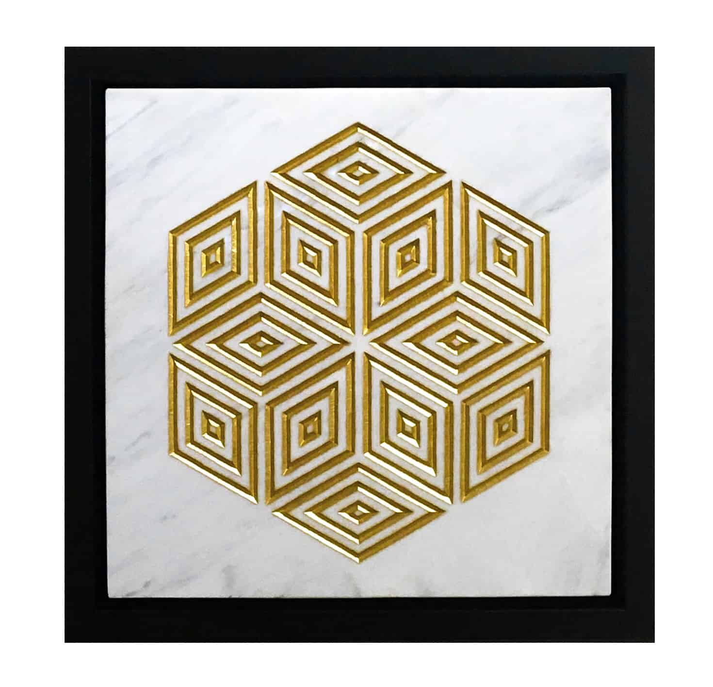 framed geometric pattern carved in white marble and gilded