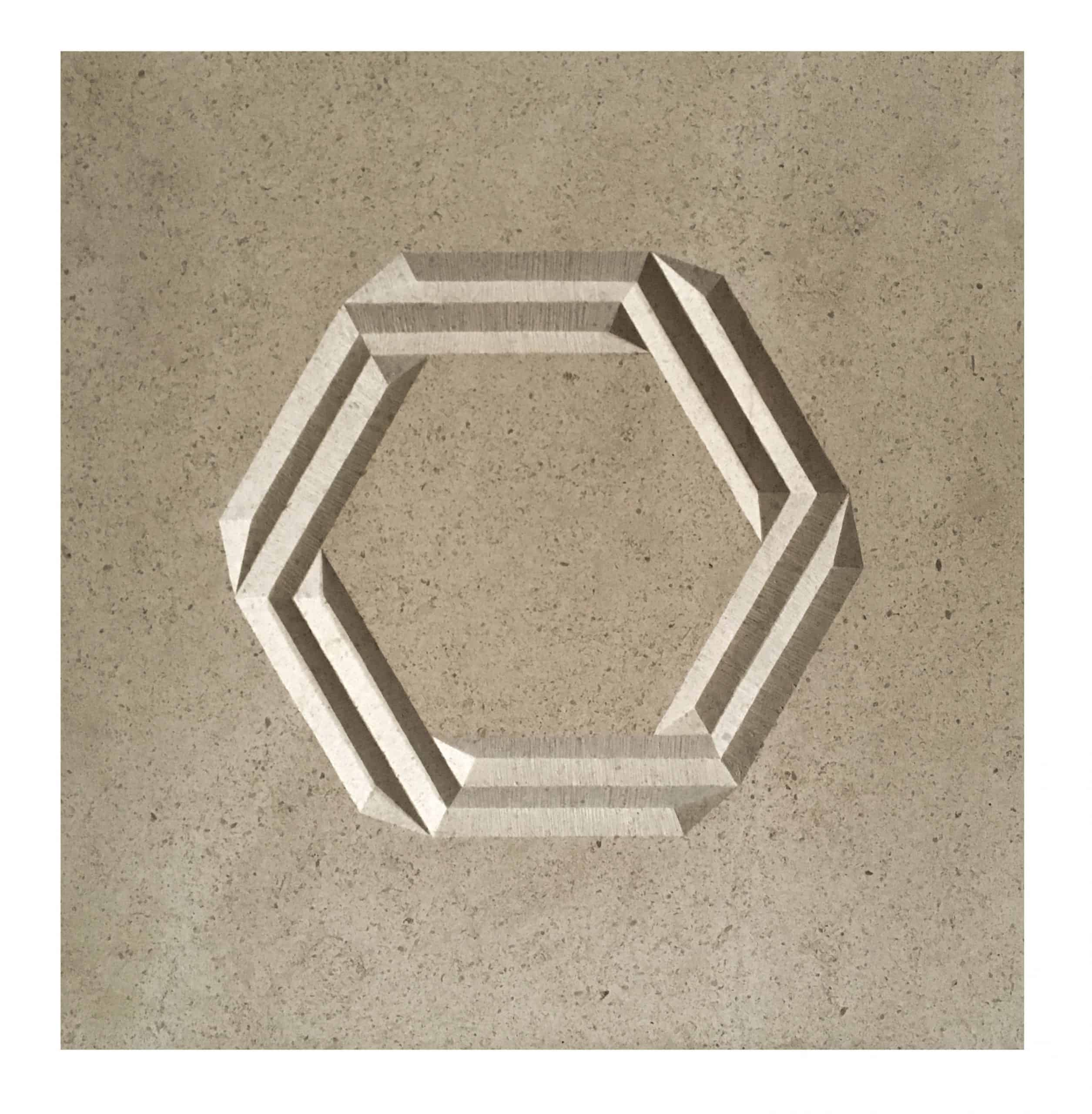 Simple hexagon carved into a buff coloured stone