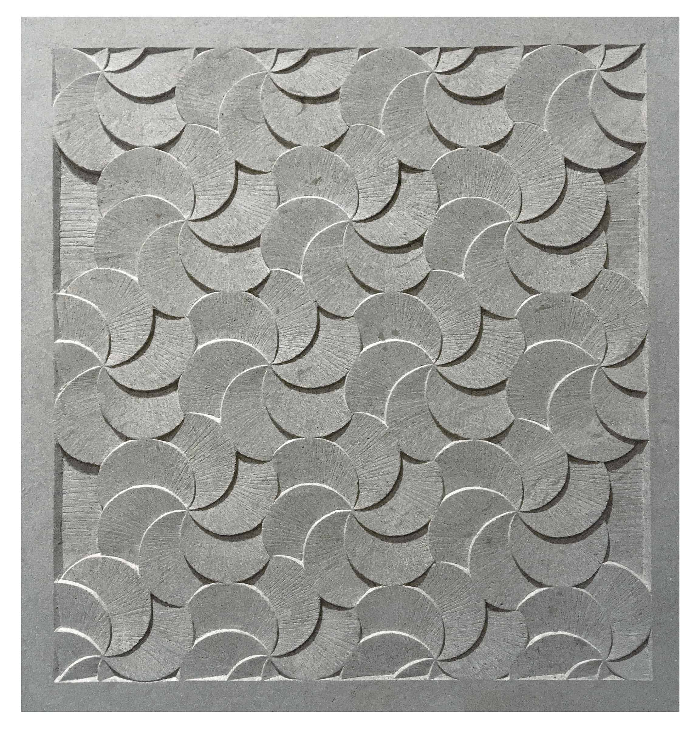 geometric pattern in shallow relief, carved in stone