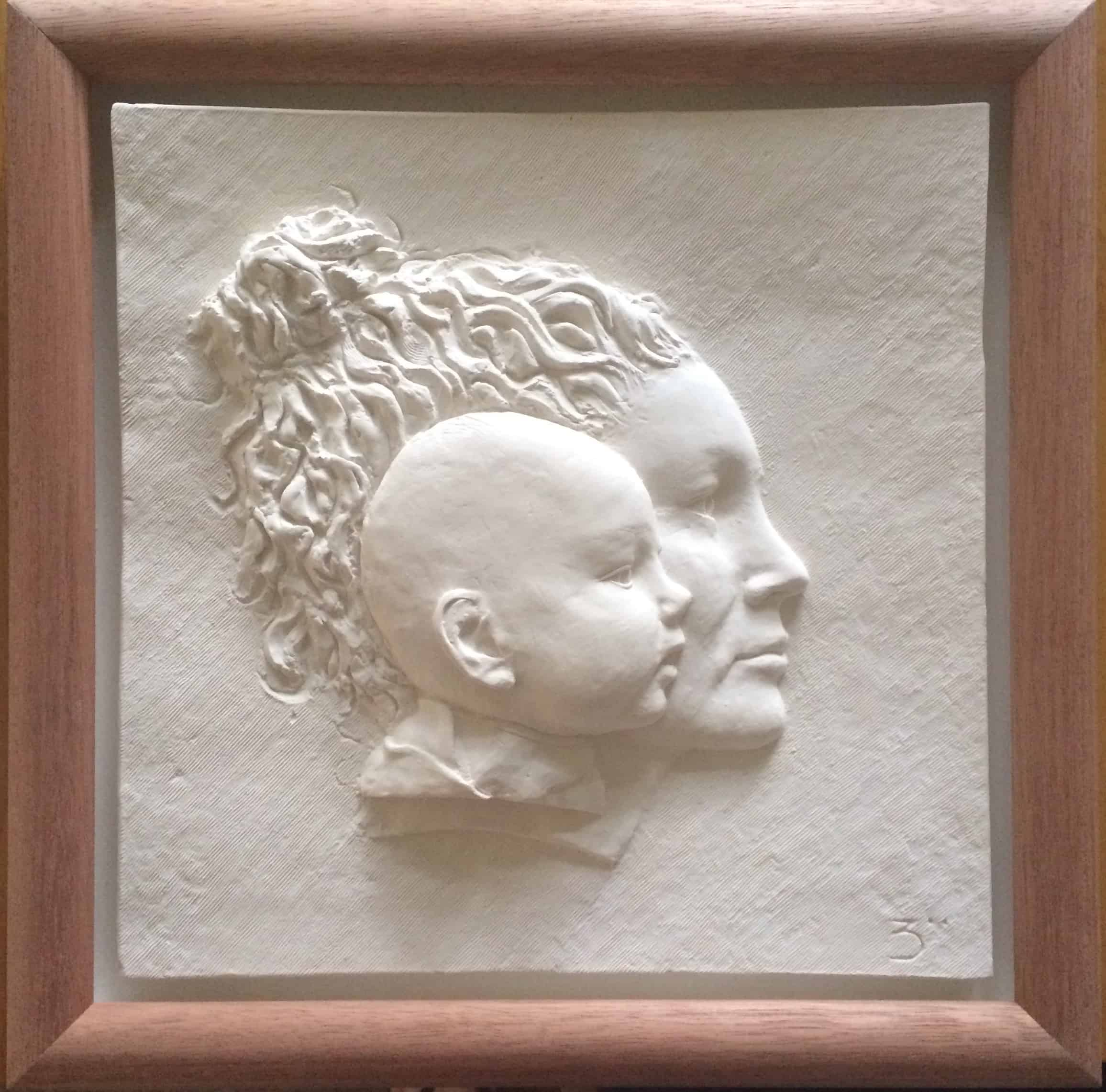 Mother and Babies head modelling in shallow relief and cast in white plaster