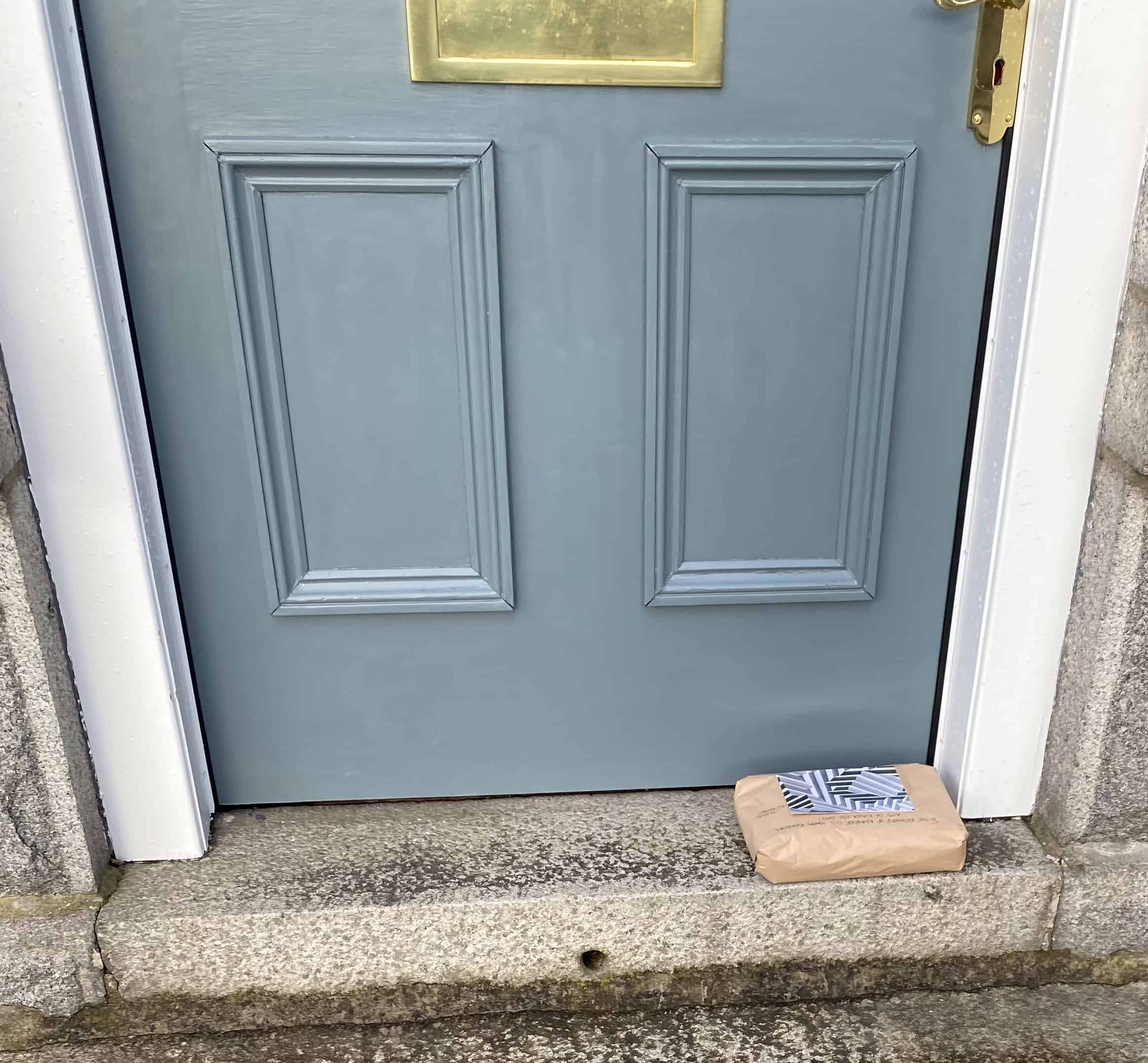 Front door step with package sitting on it